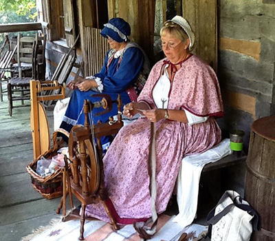 Weavers make yard on the porch at Historic Collinsville